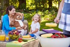 Family having dinner in garden. Happy family having dinner in garden during summer day Stock Photos