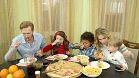 Family having dinner indoors. stock footage
