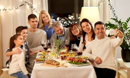 Free Family Having Dinner Party And Taking Selfie Stock Photo - 139086530