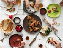 Family having dinner with roasted chicken wings Royalty Free Stock Photos