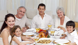 Family having a dinner together at home Stock Photo