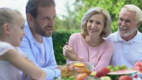 Family having dinner together, spending time with grandparents, togetherness. Stock footage stock video