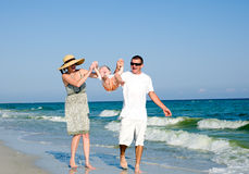 Family having fan at the beach Stock Image