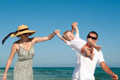 Family having fan at the beach Stock Image