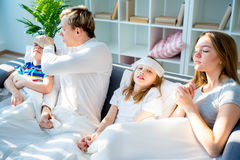 Family having flu. Family is having common flu, wiping noses royalty free stock image