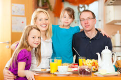 Family having food for breakfast Royalty Free Stock Images