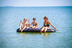 Family having fun on air bed Stock Photo