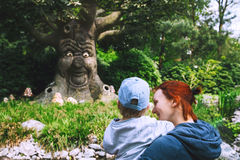 Family is having fun at amusement park Efteling, Netherlands. Royalty Free Stock Images