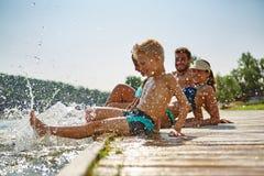 Free Family Having Fun And Splashing Water Stock Photos - 84707773