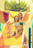 Family having fun in aquapark. Royalty Free Stock Images