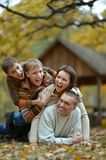 Family having fun   in autumn forest Royalty Free Stock Photo