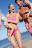 Family Having Fun On Beach. Laughing Stock Photo