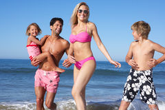Family Having Fun On Beach Stock Photography