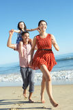 Family Having Fun On Beach. Laughing Stock Images