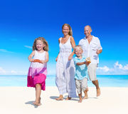 Family having fun on a beach Stock Photo