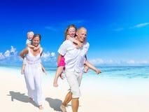 Family having fun on the beach Royalty Free Stock Photos