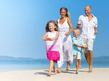 Family having fun on the beach Royalty Free Stock Photos