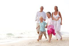 Family having fun on the beach Stock Photos