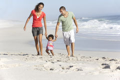 Family Having Fun On Beach Stock Photos