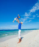 Family Having Fun on Beach. Father with her son having fun on beautiful sunny beach Stock Image