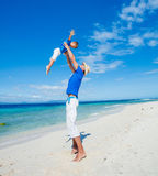 Family Having Fun on Beach. Father with her son having fun on beautiful sunny beach Stock Photos