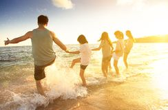 family having fun on the beach Royalty Free Stock Image