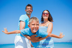 Family Having Fun on Beach Stock Images