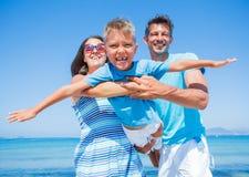 Family Having Fun on Beach Stock Photo