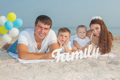 Family having fun on the beach Stock Photography