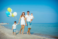 Family having fun on the beach Royalty Free Stock Photo