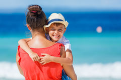 Family Having Fun on Beach. Mother with her son on beautiful sunny beach Stock Image