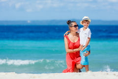 Family Having Fun on Beach. Mother with her son walking on beautiful sunny beach Royalty Free Stock Photography