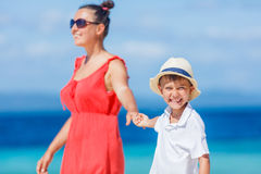 Family Having Fun on Beach. Mother with her son walking on beautiful sunny beach Stock Images