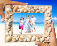 Family having fun on the beach Stock Photo