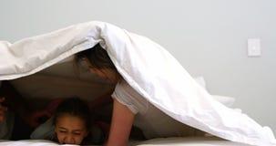 Family having fun in bedroom