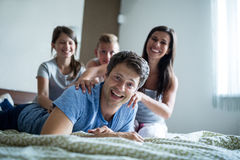 Family having fun in bedroom Royalty Free Stock Images