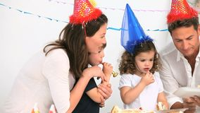 Family having fun during a birthday party Stock Images