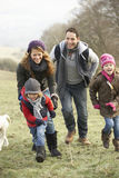 Family having fun in the country in winter Stock Image