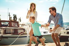 Family having fun, enjoying the summer time by the sea. Happy family having fun, enjoying the summer time by the sea royalty free stock photo
