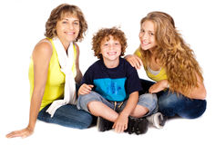 Family having fun on the floor, smiling at camera Stock Image