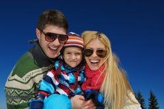 Family having fun on fresh snow at winter Stock Photo