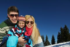 Family having fun on fresh snow at winter Stock Image