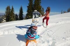 Family having fun on fresh snow at winter Stock Photos