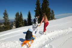 Family having fun on fresh snow at winter Stock Images