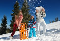 Family having fun on fresh snow at winter Stock Photos