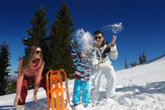 Family having fun on fresh snow at winter Royalty Free Stock Image