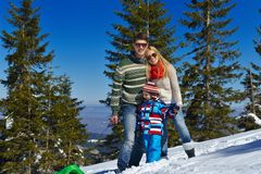 Family having fun on fresh snow at winter Royalty Free Stock Image