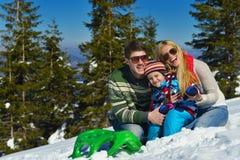 Family having fun on fresh snow at winter Royalty Free Stock Photos