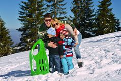 Family having fun on fresh snow at winter Royalty Free Stock Images