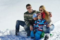 Family having fun on fresh snow at winter Royalty Free Stock Photo